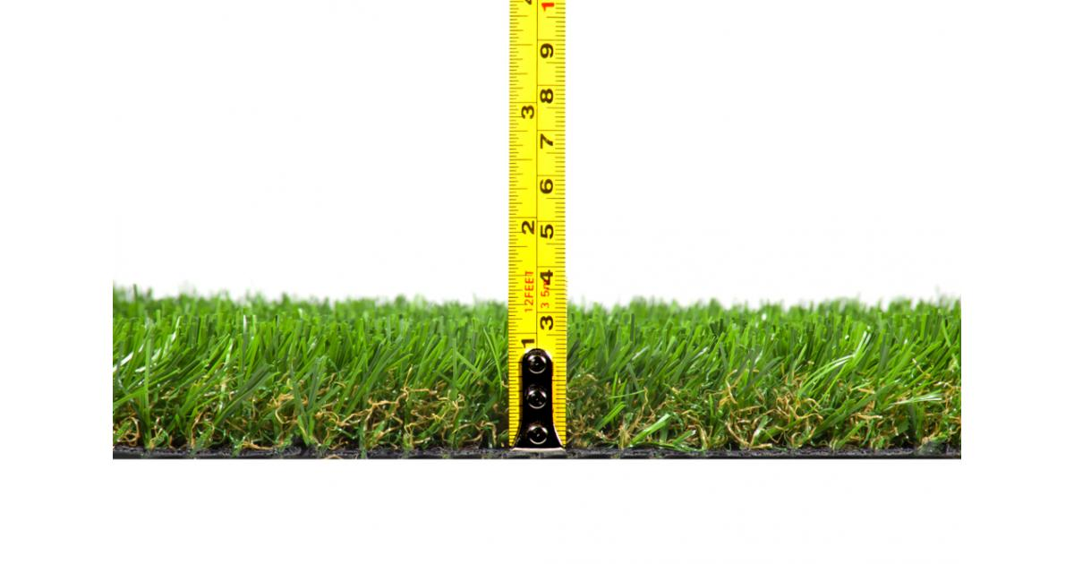 Why is it important to mow grass at the proper height in commercial landscaping?